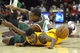 Oct 8, 2013; Cleveland, OH, USA; Cleveland Cavaliers shooting guard Carrick Felix (right) and Milwaukee Bucks small forward Khris Middleton (22) battle for a loose ball in the fourth quarter at Quicken Loans Arena. Mandatory Credit: David Richard-USA TODAY Sports