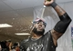 Oct 8, 2013; St. Petersburg, FL, USA; Boston Red Sox designated hitter David Ortiz pours champagne on him as he celebrates beating the Tampa Bay Rays of the American League divisional series at Tropicana Field. Boston Red Sox defeated theTampa Bay Rays 3-1. Mandatory Credit: Kim Klement-USA TODAY Sports