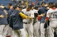 Oct 8, 2013; St. Petersburg, FL, USA; Boston Red Sox relief pitcher Koji Uehara (center) celebrates with teammates after they beat the Tampa Bay Rays in game four of the American League divisional series at Tropicana Field. Boston Red Sox defeated theTampa Bay Rays 3-1. Mandatory Credit: Kim Klement-USA TODAY Sports