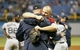 Oct 8, 2013; St. Petersburg, FL, USA; Boston Red Sox catcher David Ross (right) hugs teammates after they beat the Tampa Bay Rays in  game four of the American League divisional series at Tropicana Field. Boston Red Sox defeated theTampa Bay Rays 3-1. Mandatory Credit: Kim Klement-USA TODAY Sports