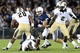 Sep 14, 2013; University Park, PA, USA; Penn State Nittany Lions linebacker Mike Hull (43) attempts to block Central Florida Knights running back William Stanback (28) during the fourth quarter at Beaver Stadium. Mandatory Credit: Matthew O'Haren-USA TODAY Sports