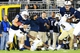 Sep 14, 2013; University Park, PA, USA; Penn State Nittany Lions running back Von Walker (25) tries to avoid a tackle during the fourth quarter against the Central Florida Knights at Beaver Stadium. Mandatory Credit: Matthew O'Haren-USA TODAY Sports