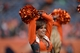 Sep 29, 2013; Denver, CO, USA; Denver Broncos cheerleader performs during the game against the Philadelphia Eagles Sports Authority Field at Mile High. The Broncos defeated the Eagles 52-20. Mandatory Credit: Ron Chenoy-USA TODAY Sports
