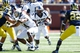 Sep 14, 2013; Ann Arbor, MI, USA; Akron Zips running back D.J. Jones (25) runs the ball against the Michigan Wolverines at Michigan Stadium. Mandatory Credit: Rick Osentoski-USA TODAY Sports