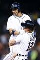 Sep 21, 2013; Detroit, MI, USA; Detroit Tigers left fielder Andy Dirks (12) lifts second baseman Omar Infante (4) off the ground after he hit a game winning walk RBI single in the twelfth inning against the Chicago White Sox at Comerica Park. Detroit won 7-6. Mandatory Credit: Rick Osentoski-USA TODAY Sports