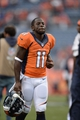 Sep 29, 2013; Denver, CO, USA; Denver Broncos wide receiver Trindon Holliday (11) leaves the field following the win over the Philadelphia Eagles at Sports Authority Field at Mile High. The Broncos defeated the Eagles 52-20. Mandatory Credit: Ron Chenoy-USA TODAY Sports