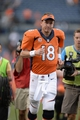 Sep 29, 2013; Denver, CO, USA; Denver Broncos quarterback Peyton Manning (18) leaves the field following the win over the Philadelphia Eagles at Sports Authority Field at Mile High. The Broncos defeated the Eagles 52-20. Mandatory Credit: Ron Chenoy-USA TODAY Sports