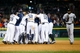 Sep 21, 2013; Detroit, MI, USA; Detroit Tigers second baseman Omar Infante (4) is mobbed by teammates after he hit a game winning RBI single in the twelfth inning against the Chicago White Sox at Comerica Park. Detroit won 7-6 in twelve innings. Mandatory Credit: Rick Osentoski-USA TODAY Sports