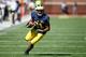 Sep 14, 2013; Ann Arbor, MI, USA; Michigan Wolverines wide receiver Jeremy Gallon (21) runs the ball against the Akron Zips at Michigan Stadium. Mandatory Credit: Rick Osentoski-USA TODAY Sports