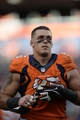Sep 29, 2013; Denver, CO, USA; Denver Broncos defensive end Derek Wolfe (95) leaves the field following the win over the Philadelphia Eagles at Sports Authority Field at Mile High. The Broncos defeated the Eagles 52-20. Mandatory Credit: Ron Chenoy-USA TODAY Sports