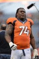 Sep 29, 2013; Denver, CO, USA; Denver Broncos tackle Orlando Franklin (74) leaves the field following the win over the Philadelphia Eagles at Sports Authority Field at Mile High. The Broncos defeated the Eagles 52-20. Mandatory Credit: Ron Chenoy-USA TODAY Sports