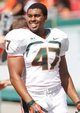 Sep 28, 2013; Tampa, FL, USA; Miami Hurricanes linebacker Akil Craig (47) against the South Florida Bulls during the second half at Raymond James Stadium. Miami Hurricanes defeated the South Florida Bulls 49-21. Mandatory Credit: Kim Klement-USA TODAY Sports