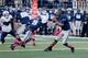 Oct 4, 2013; Logan, UT, USA; Utah State Aggies quarterback Chuckie Keeton (16) looks to pass the ball against Brigham Young Cougars at Romney Stadium.  Brigham Young Cougars defeated the Utah State Aggies 31-14.  Mandatory Credit: Chris Nicoll-USA TODAY Sports
