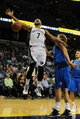 Oct 9, 2013; Memphis, TN, USA; Memphis Grizzlies point guard Jerryd Bayless (7) is fouled by Dallas Mavericks power forward Dirk Nowitzki (41) at FedExForum. Mandatory Credit: Justin Ford-USA TODAY Sports