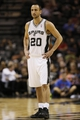 Oct 9, 2013; San Antonio, TX, USA; San Antonio Spurs guard Manu Ginobili (20) looks on during the first half against the CSKA Moscow at the AT&T Center. Mandatory Credit: Soobum Im-USA TODAY Sports