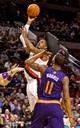 Oct 9, 2013; Portland, OR, USA; Portland Trail Blazers center LaMarcus Aldridge (12) shoots over Phoenix Suns power forward Markieff Morris (11) in the first quarter at the Moda Center. Mandatory Credit: Craig Mitchelldyer-USA TODAY Sports