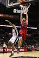 Oct 9, 2013; San Antonio, TX, USA; CSKA Moscow player Viktor (C) Khryapa (31) dunks past San Antonio Spurs forward Boris Diaw (left) during the second half at the AT&T Center. Mandatory Credit: Soobum Im-USA TODAY Sports