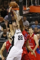 Oct 9, 2013; San Antonio, TX, USA; San Antonio Spurs forward Tiago Splitter (22) drives to the basket to dunk the ball past CSKA Moscow center Kyle Hines (42) during the second half at the AT&T Center. The Spurs won 95-93 in overtime. Mandatory Credit: Soobum Im-USA TODAY Sports