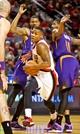 Oct 9, 2013; Portland, OR, USA; Portland Trail Blazers point guard Damian Lillard (0) drives to the basket past Phoenix Suns power forward Markieff Morris (11) in the first quarter at the Moda Center. Mandatory Credit: Craig Mitchelldyer-USA TODAY Sports