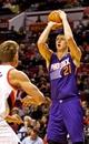 Oct 9, 2013; Portland, OR, USA; Phoenix Suns center Alex Len (21) shoots over Portland Trail Blazers center Meyers Leonard (11) at the Moda Center. Mandatory Credit: Craig Mitchelldyer-USA TODAY Sports
