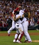 Oct 9, 2013; St. Louis, MO, USA; St. Louis Cardinals starting pitcher Adam Wainwright (right) celebrates with catcher Yadier Molina (left) and shortstop Daniel Descalso (back) after defeating the Pittsburgh Pirates in game five of the National League divisional series playoff baseball game at Busch Stadium. The Cardinals won 6-1. Mandatory Credit: Scott Rovak-USA TODAY Sports