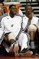 Oct 10, 2013; Auburn Hills, MI, USA; Miami Heat small forward LeBron James (left) power forward Chris Bosh (right) sit on the bench during the fourth quarter against the Detroit Pistons at The Palace of Auburn Hills. Heat beat the Pistons 112-107. Mandatory Credit: Raj Mehta-USA TODAY Sports