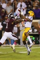 Oct 5, 2013; Starkville, MS, USA; LSU Tigers wide receiver Odell Beckham (3) receives a pass over Mississippi State Bulldogs defensive back Nickoe Whitley (1) during the game at Davis Wade Stadium.  LSU Tigers defeated the Mississippi State Bulldogs 59-26.  Mandatory Credit: Spruce Derden-USA TODAY Sports