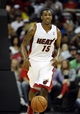 Oct 11, 2013; Kansas City, MO, USA; Miami Heat point guard Mario Chalmers (15) brings the ball up court against the Charlotte Bobcats in the second half at Sprint Center. Miami won 86-75. Mandatory Credit: John Rieger-USA TODAY Sports
