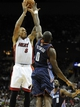 Oct 11, 2013; Kansas City, MO, USA; Miami Heat small forward Michael Beasley (8) shoots over Charlotte Bobcats power forward Bismack Biyombo (0) in the second half at Sprint Center. Miami won 86-75. Mandatory Credit: John Rieger-USA TODAY Sports