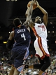Oct 11, 2013; Kansas City, MO, USA; Miami Heat small forward Eric Griffin (17) is fouled by Charlotte Bobcats small forward Jeff Adrien (4) in the second half at Sprint Center. Miami won 86-75. Mandatory Credit: John Rieger-USA TODAY Sports