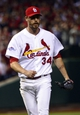 Oct 11, 2013; St. Louis, MO, USA; St. Louis Cardinals relief pitcher John Axford (34) reacts after retiring the Los Angeles Dodgers in the 11th inning in game one of the National League Championship Series baseball game at Busch Stadium. Mandatory Credit: Scott Rovak-USA TODAY Sports