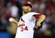 Oct 11, 2013; St. Louis, MO, USA; St. Louis Cardinals relief pitcher John Axford throws a pitch against the Los Angeles Dodgers during the 11th inning in game one of the National League Championship Series baseball game at Busch Stadium. Mandatory Credit: Jeff Curry-USA TODAY Sports
