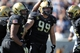 Oct 12, 2013; West Point, NY, USA; Army Black Knights defensive end Robert Kough (99) celebrates with defensive end Jarrett Mackey (34) during the first half against the Eastern Michigan Eagles at Michie Stadium. Mandatory Credit: Danny Wild-USA TODAY Sports