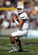 Oct 12, 2013; West Point, NY, USA; Eastern Michigan Eagles quarterback Tyler Benz (12) drops back to pass during the first half against the Army Black Knights at Michie Stadium. Mandatory Credit: Danny Wild-USA TODAY Sports