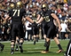 Oct 12, 2013; West Point, NY, USA; Army Black Knights kicker Daniel Grochowski (95) celebrates with offensive lineman Richard Rainey (71) after kicking an extra point during the first half against the Eastern Michigan Eagles at Michie Stadium. Mandatory Credit: Danny Wild-USA TODAY Sports