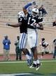 Oct 12, 2013; Durham, NC, USA; Duke Blue Devils wide receiver Jamison Crowder (3) celebrates with wide receiver Issac Blakeney (17) after Blakeney scored against Navy Midshipmen at Wallace Wade Stadium. Mandatory Credit: Mark Dolejs-USA TODAY Sports