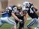 Oct 12, 2013; Durham, NC, USA; Duke Blue Devils safety Corbin McCarthy (26) and linebacker David Helton (47) tackle Navy Midshipmen running back Marcus Thomas (26) at Wallace Wade Stadium. Mandatory Credit: Mark Dolejs-USA TODAY Sports
