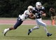 Oct 12, 2013; Durham, NC, USA; Navy Midshipmen safety Chris Ferguson (23) tackles Duke Blue Devils wide receiver Max McCaffrey (87) at Wallace Wade Stadium. Mandatory Credit: Mark Dolejs-USA TODAY Sports
