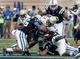 Oct 12, 2013; Durham, NC, USA; Duke Blue Devils safety Jeremy Cash (16) tackles Navy Midshipmen running back Ryan Williams-Jenkins (24) in their game at Wallace Wade Stadium. Mandatory Credit: Mark Dolejs-USA TODAY Sports