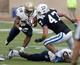 Oct 12, 2013; Durham, NC, USA; Duke Blue Devils linebacker David Helton (47) tackles Navy Midshipmen running back Marcus Thomas (26) in their game at Wallace Wade Stadium. Mandatory Credit: Mark Dolejs-USA TODAY Sports