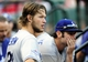 Oct 12, 2013; St. Louis, MO, USA; Los Angeles Dodgers starting pitcher Clayton Kershaw (left) looks out from the dugout during the seventh inning against the St. Louis Cardinals in game two of the National League Championship Series baseball game at Busch Stadium. Mandatory Credit: Jeff Curry-USA TODAY Sports