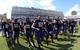 Oct 12, 2013; Fort Worth, TX, USA; TCU Horned Frogs players Tyler Matthews (12), Joey Hunt (55), Cam White (88), Aviante Collins (69), Halapoulivaati Vaitai (74), Bobby Thompson (72) and Marcus Mallet (54) gesture with the Horned Frog hand symbol in celebration after the game against the Kansas Jayhawks at Amon G. Carter Stadium. TCU defeated Kansas 27-17. Mandatory Credit: Kirby Lee-USA TODAY Sports