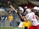 Oct 12, 2013; Laramie, WY, USA; Laramie, WY, USA; Wyoming Cowboys quarterback Brett Smith (16) throws against New Mexico Lobos linebacker Dakota Cox (49) during the second quarter at War Memorial Stadium. The Cowboys beat the Lobos 38-31. Mandatory Credit: Troy Babbitt-USA TODAY Sports