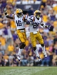 Oct 12, 2013; Baton Rouge, LA, USA; LSU Tigers defensive back Tre'Davious White (16) and cornerback Jalen Mills (28)  Mills' sack of Florida Gators quarterback Tyler Murphy (3) in the fourth quarter of their game at Tiger Stadium. Mandatory Credit: Chuck Cook-USA TODAY Sports