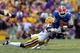 Oct 12, 2013; Baton Rouge, LA, USA; Florida Gators quarterback Tyler Murphy (3) is sacked in the fourth quarter by LSU Tigers cornerback Jalen Mills (28) during their game at Tiger Stadium. Mandatory Credit: Chuck Cook-USA TODAY Sports