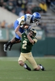 Oct 12, 2013; Fort Collins, CO, USA; San Jose State Spartans cornerback Bene Benwikere (21) intercepts a pass intended for Colorado State Rams wide receiver Thomas Coffman (2) in the fourth quarter at Hughes Stadium. The Spartans defeated the Rams 34-27. Mandatory Credit: Ron Chenoy-USA TODAY Sports