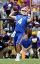Oct 12, 2013; Baton Rouge, LA, USA; Florida Gators punter Kyle Christy (4) throws a pass on a fake punt in the fourth quarter of their game against the LSU Tigers at Tiger Stadium. Mandatory Credit: Chuck Cook-USA TODAY Sports