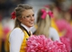 Oct 12, 2013; Laramie, WY, USA; Laramie, WY, USA; A Wyoming Cowboys cheerleader performs during a game against the New Mexico Lobos during the fourth quarter at War Memorial Stadium. The Cowboys beat the Lobos 38-31. Mandatory Credit: Troy Babbitt-USA TODAY Sports