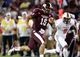 Oct 12, 2013; Starkville, MS, USA; Mississippi State Bulldogs quarterback Dak Prescott (15) carries the ball for a touchdown against the Bowling Green Falcons at Davis Wade Stadium. Mandatory Credit: Marvin Gentry-USA TODAY Sports