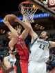 Oct 12, 2013; Minneapolis, MN, USA; Toronto Raptors power forward Tyler Hansbrough (50) shoots against Minnesota Timberwolves power forward Kevin Love (42) in the second quarter at Target Center. Raptors won 104-97. Mandatory Credit: Greg Smith-USA TODAY Sports
